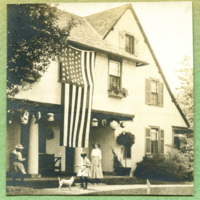 American flag displayed on the front facade of Ragdale