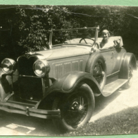 """""""Modern transportation"""" the automobile, in driver's seat Theo"""