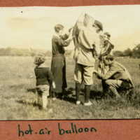 Children and adults making ready the hot-air balloon