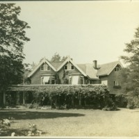 Franklin P. Smith estate, Deerpath, Lake Forest, Illinois-- House east facade and lawn.jpg
