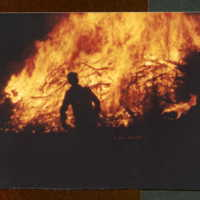 Silhouette of Ted Bergsma - the bonfire is in the background