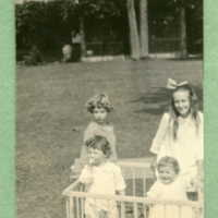 Jack, Theo [Frances Theodora Shaw], Shaw, and Alice outdoors. The two youngest children are in a playpen